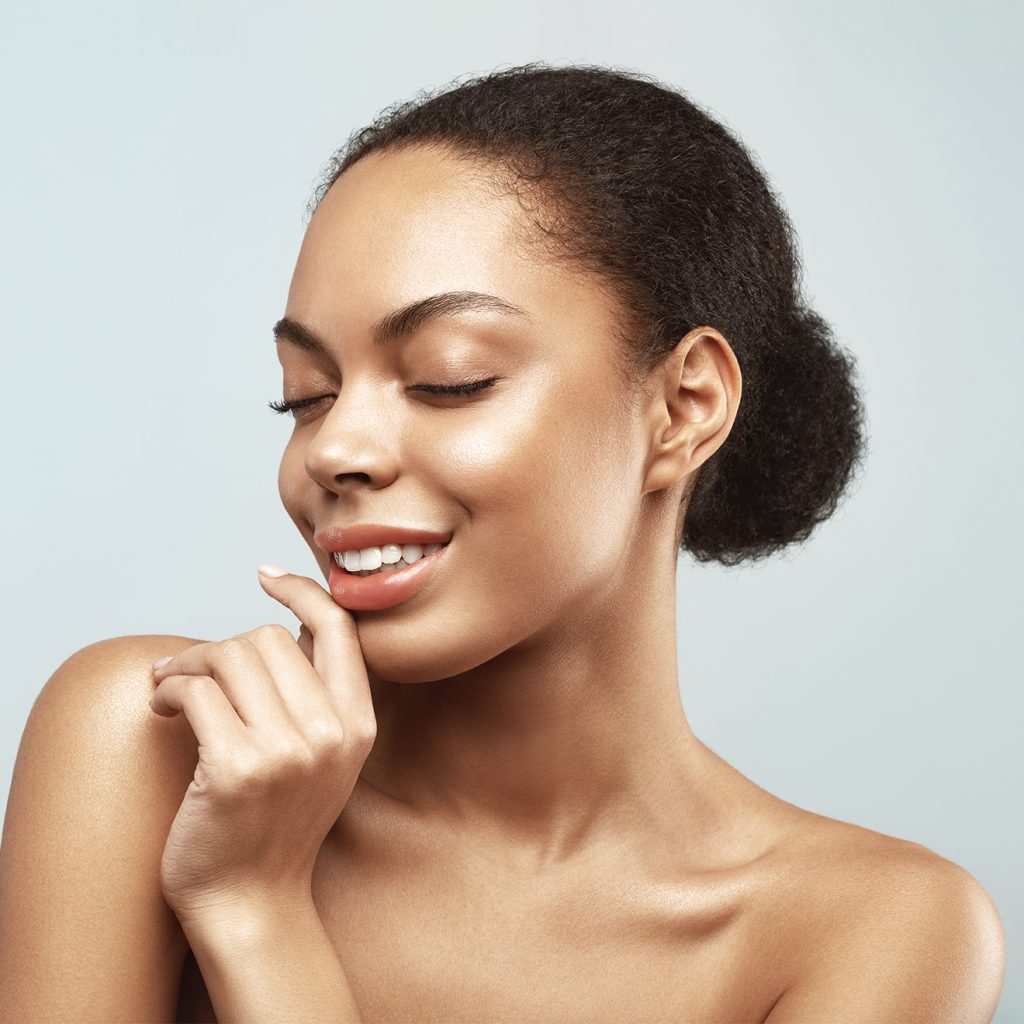 African American skincare model. Beauty spa treatment concept