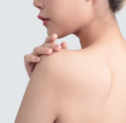 Woman's back with clean, smooth skin feeling shoulder